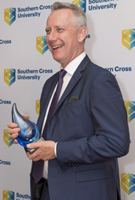 Vice Chancellor Professor Adam Shoemaker smiling