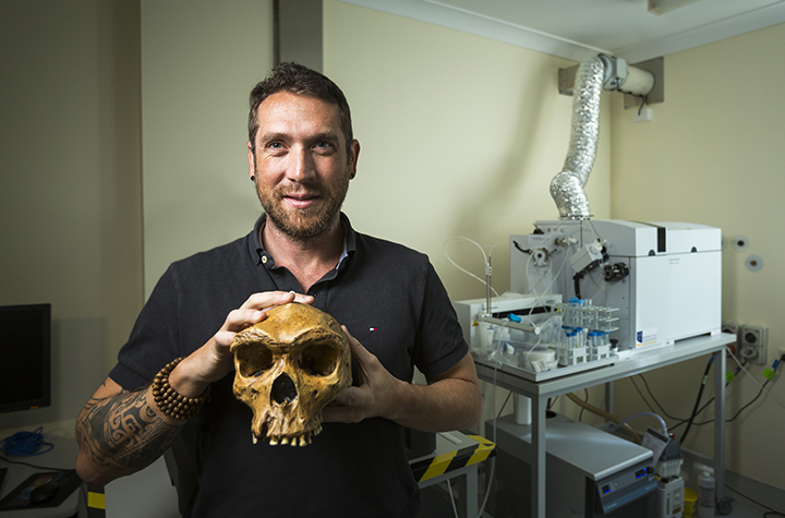Dr Renaud Joannes-Boyau holding cast of Kabwe skull in 2017