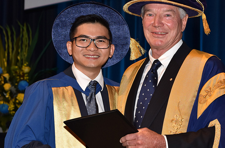 Panha Heng with Chancellor Nick Burton Taylor