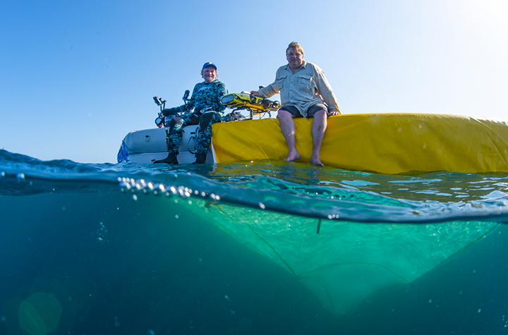 Project leader Professor Peter Harrison and QUT Professor Matthew Dunbabin with Larvalbot atop a coral nursery - photo Gary Cranitch