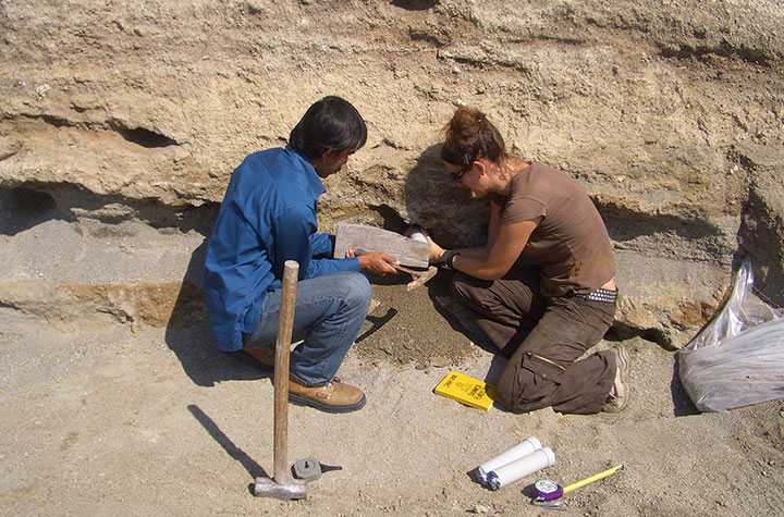 Kira Westaway and Iwan Kurniawan collecting a sediment sample for dating from the Sembungan terrace excavation.
