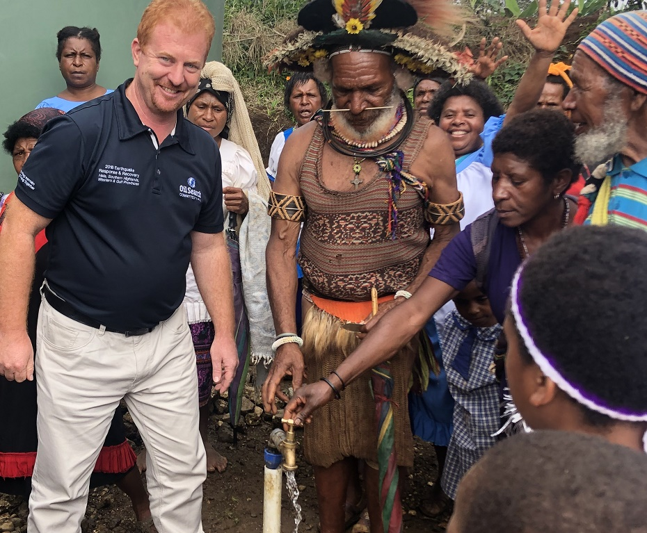 Rod with a group of people in PNG