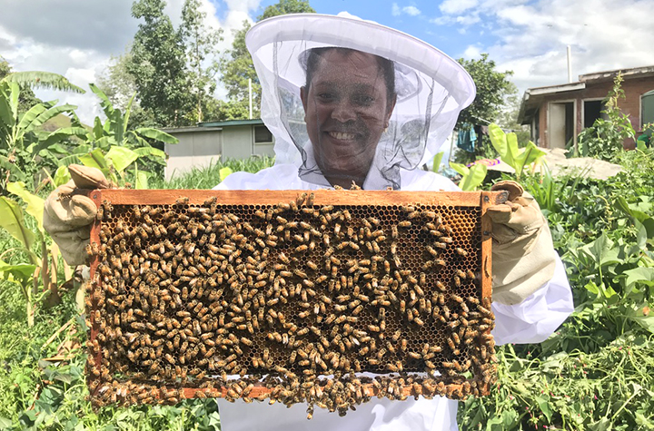 Villager with hive frame credit Cooper Schouten