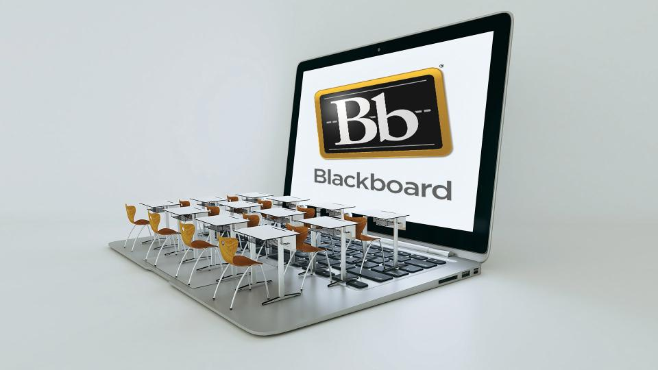 classroom desks on a laptop with Blackboard lgo on the screen