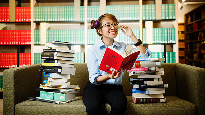 International law student reading books in library