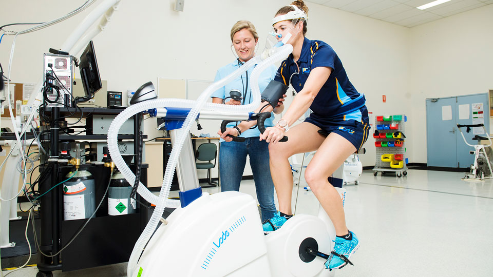D'Arcy Van den Bossche and Jessica Brennan use the LODE Excalibur Sport Cycle Ergometer in the movement room in P Block at Lismore campus